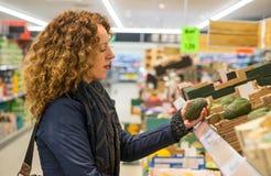 Woman shopping for avocado Stock Photo