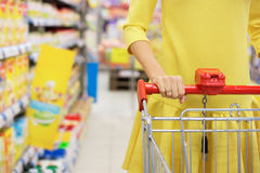 Woman shopping for baby food Stock Photo