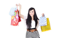 Woman with Shopping Bag. Asian woman with her shopping bags isolated on white Stock Image