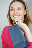 Woman with shopping bag. Beautiful smiling young woman with shopping, gift bag Royalty Free Stock Images