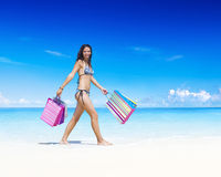 Woman with shopping bag on the beach Stock Image