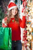 Woman With Shopping Bag Buying Christmas Ornaments Royalty Free Stock Photos