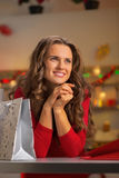Woman with shopping bag in christmas kitchen Stock Photography