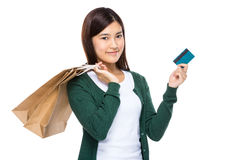 Woman with shopping bag and credit card Stock Photography
