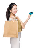 Woman with shopping bag and credit card Stock Image