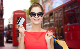 Woman with shopping bag in and credit card london Stock Photos