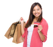 Woman with shopping bag and credit card Royalty Free Stock Photo