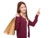 Woman with shopping bag and finger up Royalty Free Stock Images