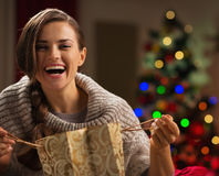 Woman with shopping bag in front of Christmas tree Royalty Free Stock Photos