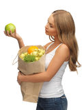 Woman with shopping bag full of fruits Stock Photography