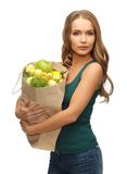 Woman with shopping bag full of fruits Stock Image