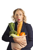 Woman with shopping bag full of vegetarian food Royalty Free Stock Image