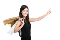 Woman with shopping bag and hand point to direction Stock Photos