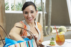 Woman With Shopping Bag Having Refreshments Royalty Free Stock Photography