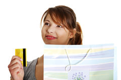 Woman with shopping bag holding credit card Royalty Free Stock Photo