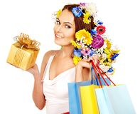 Woman with shopping bag holding flower. Isolated royalty free stock image