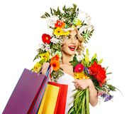 Woman with shopping bag holding flower. Stock Photography