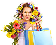 Woman with shopping bag holding flower. Royalty Free Stock Photos