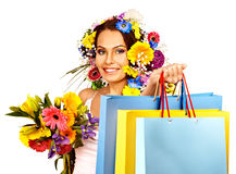 Woman with shopping bag holding flower. Royalty Free Stock Images