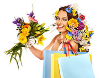 Woman with shopping bag holding flower. Stock Images