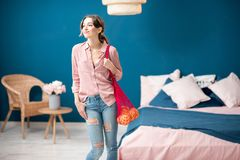 Woman with shopping bag at home Royalty Free Stock Photo