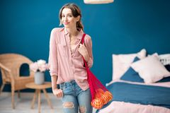 Woman with shopping bag at home Royalty Free Stock Images