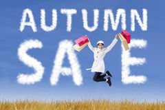 Woman with shopping bag jumping in autumn Royalty Free Stock Image