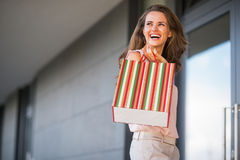 Woman with shopping bag looking on copy space Stock Image