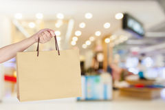 Woman with shopping bag in shopping mall Royalty Free Stock Photo