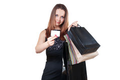 Woman with shopping bag showing a credit card Stock Photo