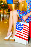 Woman with shopping bag. Sitting woman with shopping bag in her hand Stock Photos