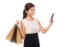 Woman with shopping bag and take selfie Stock Photography