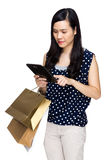 Woman with shopping bag and touch on tablet Stock Photos