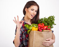 Woman shopping bag of vegetables Stock Photos