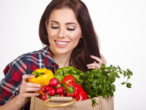 Woman shopping bag of vegetables Royalty Free Stock Images