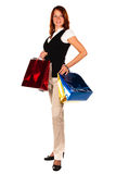 Woman after shopping with bags. Beautiful woman is done with shopping, four colored bags raised to the waist level. Isolated royalty free stock images