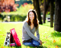 Woman with shopping bags. Young woman with shopping bags in summer park Stock Images