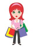Woman with Shopping Bags. Pretty red headed lady with lots of shopping bags Stock Images
