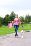 Woman with shopping bags. On the track with her puppy Royalty Free Stock Photo