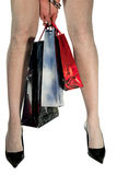Woman with shopping bags. Woman In Shopping, isolated on white bavkground Royalty Free Stock Images