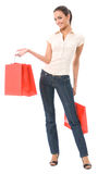 Woman with shopping bags. Isolated on white Royalty Free Stock Image