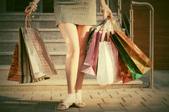 Woman with shopping bags against a mall. Steps Royalty Free Stock Photos