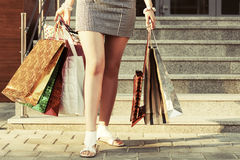 Woman with shopping bags against a mall steps Stock Images