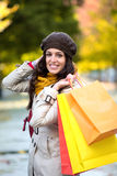 Woman with shopping bags in autumn Royalty Free Stock Photography