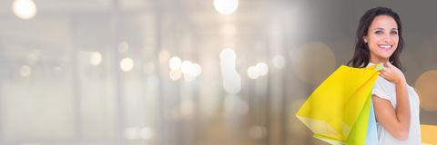 Woman shopping with bags and blurred lights transition Royalty Free Stock Photography