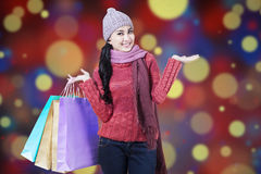 Woman with shopping bags and bokeh background Royalty Free Stock Photos