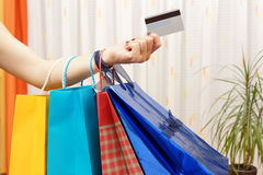 Woman with  shopping bags bought with a debit or credit card Stock Images
