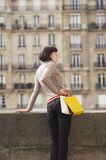 Woman With Shopping Bags On Bridge Against Town Houses Stock Image