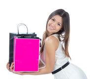 Woman with shopping bags buying presents Stock Photos