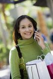 Woman With Shopping Bags On Call Royalty Free Stock Image
